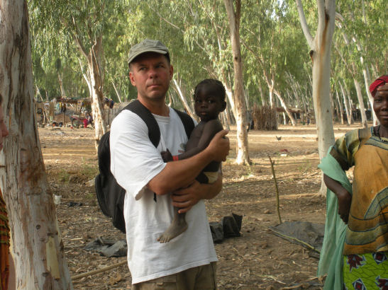 Holding a baby in Mali