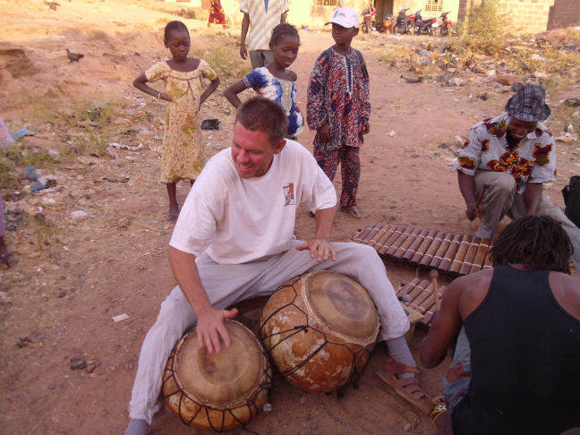 Playing drums in Mali